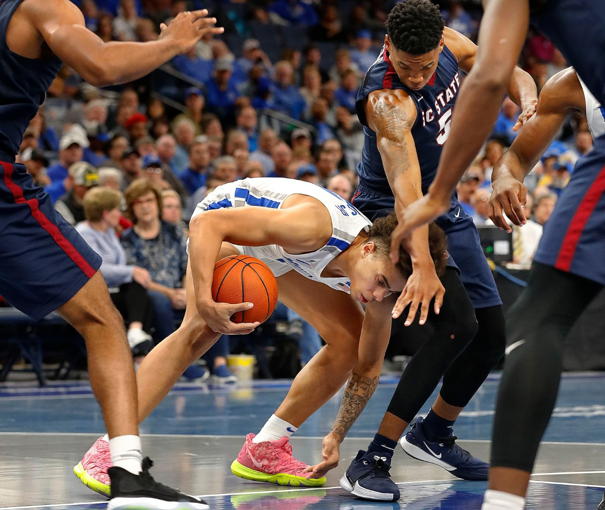<strong>Guard Lester Quinones (with ball) scoops up a loose ball against South Carolina State Nov. 5 at FedExForum.</strong> (Mark Weber/Daily Memphian)