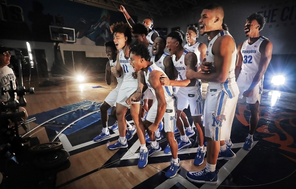 <strong>The Tigers get energized for the camera during a photo session with the University of Memphis basketball team on Oct. 11, 2019, at the Laurie-Walton Family Basketball Center. Tigers team members gathered for the annual team photo and to shoot promo and intro videos for the season.</strong> (Jim Weber/Daily Memphian)