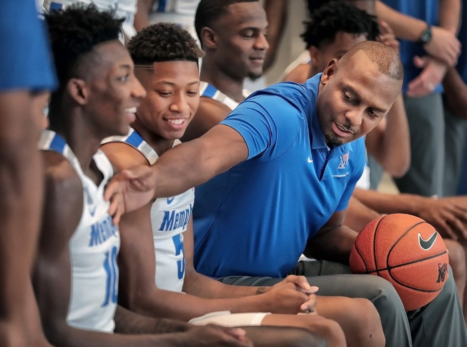 <strong>Penny Hardaway sits with his team during a photo session with the University of Memphis basketball team on Oct. 11, 2019.</strong> (Jim Weber/Daily Memphian)