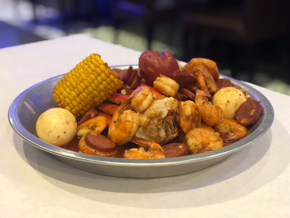 <strong>The Famous Low Country Boil at Ocean Blue includes shrimp, sausage, crab legs, corn, potatoes and boiled eggs.</strong> (Jennifer Biggs/Daily Memphian)