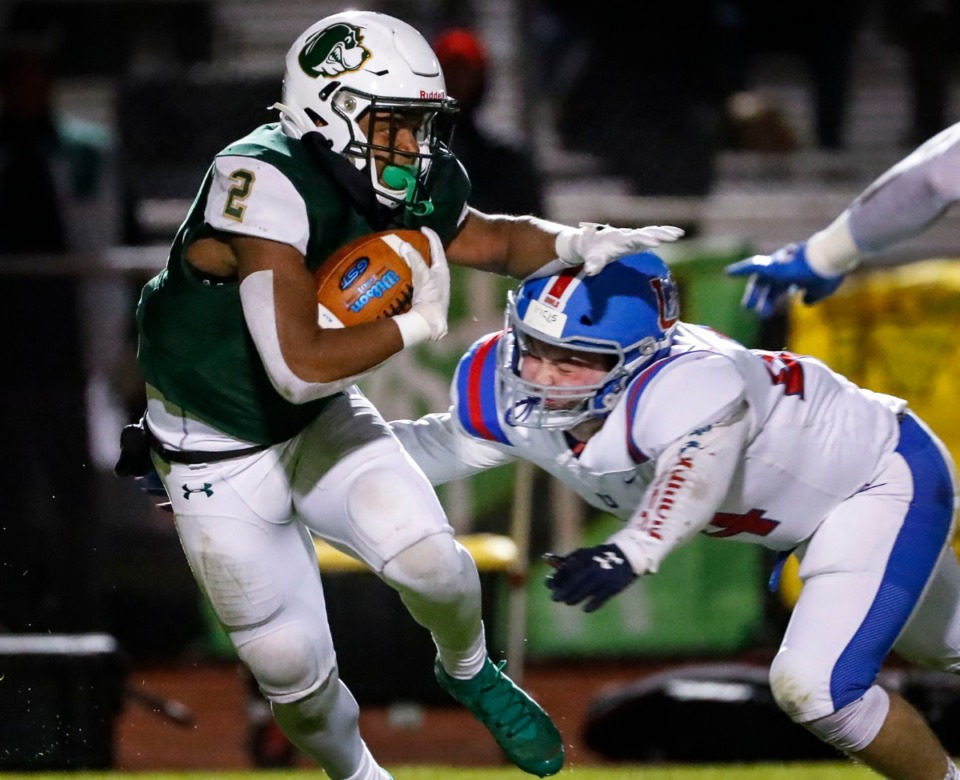 <strong>Briarcrest punt returner Jabari Small (left) is tackled by MUS defender Robert Dickinson (right) during action in their high school football game Friday, Nov. 1, 2019.</strong> (Mark Weber/Daily Memphian)