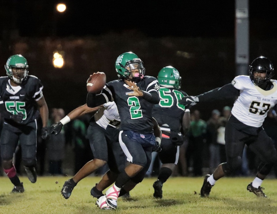 <strong>White Station High School quarterback Dwight Holmes (2) passes against Whitehaven Oct. 11. Holmes and the Spartans take on Bartlett, which has an identical 6-4 record, in the first round.</strong> (Patrick Lantrip/Daily Memphian)