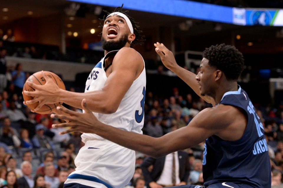 <strong>Minnesota Timberwolves center Karl-Anthony Towns (32) moves for shooting position against Memphis Grizzlies forward Jaren Jackson Jr. (13)&nbsp; Nov. 6 at FedExForum.</strong> (Brandon Dill/AP)