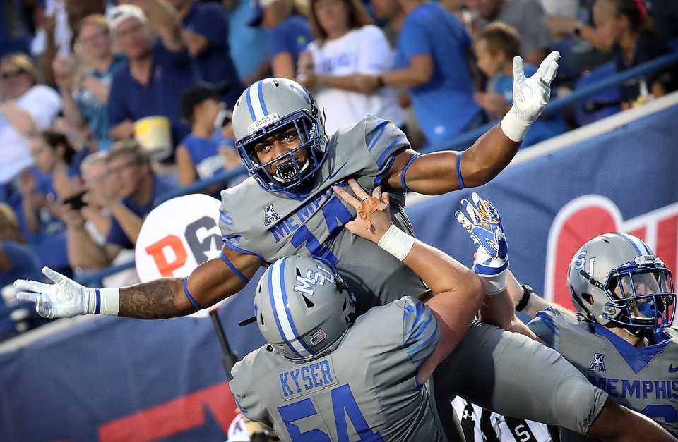 Tiger's receiver Antonio Gibson (14) and lineman Drew Kyser celebrate after a touchdown during the Tiger's game against Georgia State at the Liberty Bowl Memorial Stadium on September 14, 2018. The University of Memphis beat Georgia 59-22. (Jim Weber/Daily Memphian)
