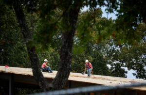 <strong>Construction workers lay roofing on a new activity center at Youth Villages' Bartlett campus Wednesday, Nov. 6, 2019.</strong> (Mark Weber/Daily Memphian)