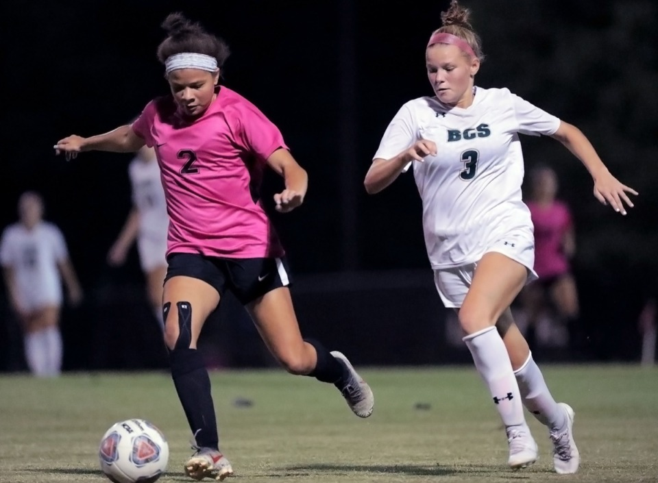 <strong>Briarcrest's Sydney Ham (3) chases Houston High's Kirsten Monk (2) on Oct. 2.</strong>&nbsp;<strong>She scored three goals Thursday in the Division 2-AA semifinals.</strong> (Patrick Lantrip/Daily Memphian)