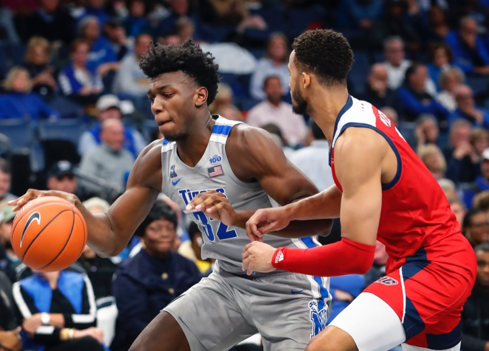 <strong>Memphis center James Wiseman (left) drives the lane against UIC's Jacob Wiley Nov. 8 at FedExForum.</strong> (Mark Weber/Daily Memphian)