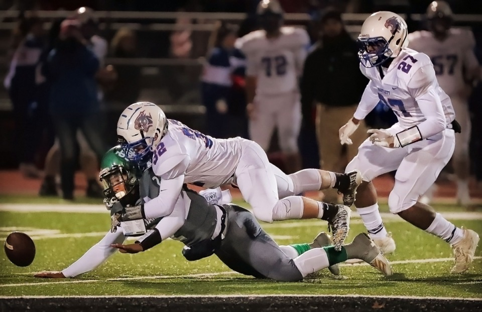 <strong>Bartlett's (32) Lucas Luster battles for a fumble with White Station quarterback Dwight Holmes during at Cordova on Nov. 8.</strong> (Jim Weber/Daily Memphian)