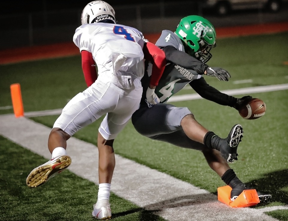 <strong>White Station's Jaylen Caver can't quite get the touchdown as he is tackled on the goal line by Bartlett's Marico Smith (left) at Cordova on Nov. 8.</strong> (Jim Weber/Daily Memphian)