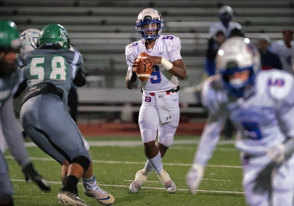 <strong>Bartlett quarterback Ty Mcneal looks for an open receiver during White Station's game against Bartlett at Cordova on Nov. 8.</strong> (Jim Weber/Daily Memphian)
