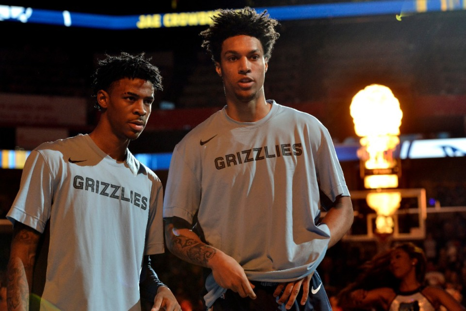 <strong>Memphis Grizzlies guard Ja Morant, left, and forward Brandon Clarke stand on the court during player introductions before an NBA basketball game against the Houston Rockets Monday, Nov. 4, 2019, in Memphis, Tenn.</strong> (AP Photo/Brandon Dill)