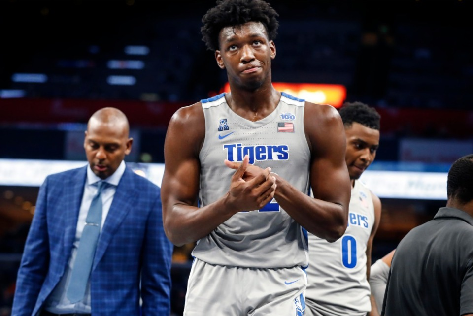 <strong>Hours after receiving a temporary restraining order allowing him to play, University of Memphis center James Wiseman (middle) scored 17 points during the game against&nbsp;<span>Illinois-Chicago&nbsp;</span>on Nov. 8, 2019, at the FedExForum.</strong> (Mark Weber/Daily Memphian)