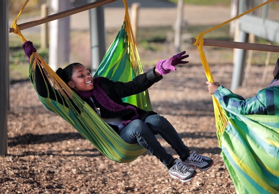 <strong>Niyah Garland, 10, tries to nab the next swing as folks gather at the River Garden in Mississippi River Park on Nov. 9, 2019, for a first anniversary celebration with yoga, fire pits and birthday cake. The Memphis River Parks Partnership is planning to build on its success with the garden by finding ways to link with Memphis Park on the nearby bluff where construction work is already underway.</strong> (Jim Weber/Daily Memphian)