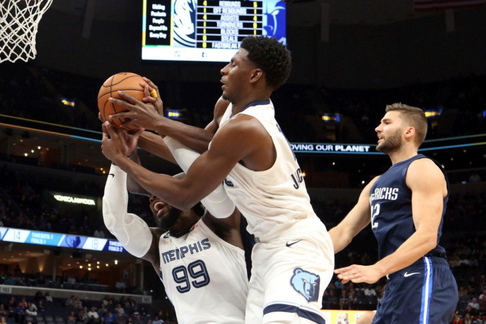 <strong>Memphis Grizzlies' Jaren Jackson Jr. (13) and Jae Crowder (99) grab a rebound during the first half of the game against Dallas Mavericks on Nov. 9, 2019, in Memphis.</strong> (AP Photo/Karen Pulfer Focht)