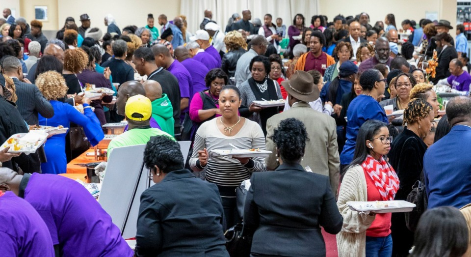 <strong>A crowd jams the fellowship hall at Mississippi Boulevard Christian Church on Nov. 10, 2019, for the annual Taste of the Boulevard.</strong> (Mike Kerr/Special to Daily Memphian)