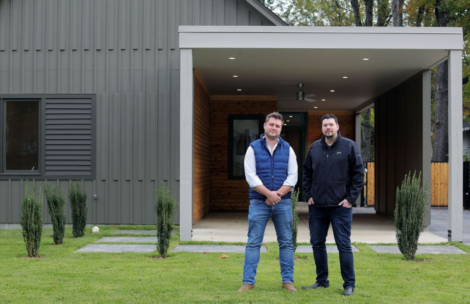 <strong>Developer Laurynas 'LP' Petrauskas (left) and architect Jason Jackson (right) stand in front of a Midtown home the pair designed and built at 1438 Tutwiler.</strong>&nbsp;(Patrick Lantrip/Daily Memphian)