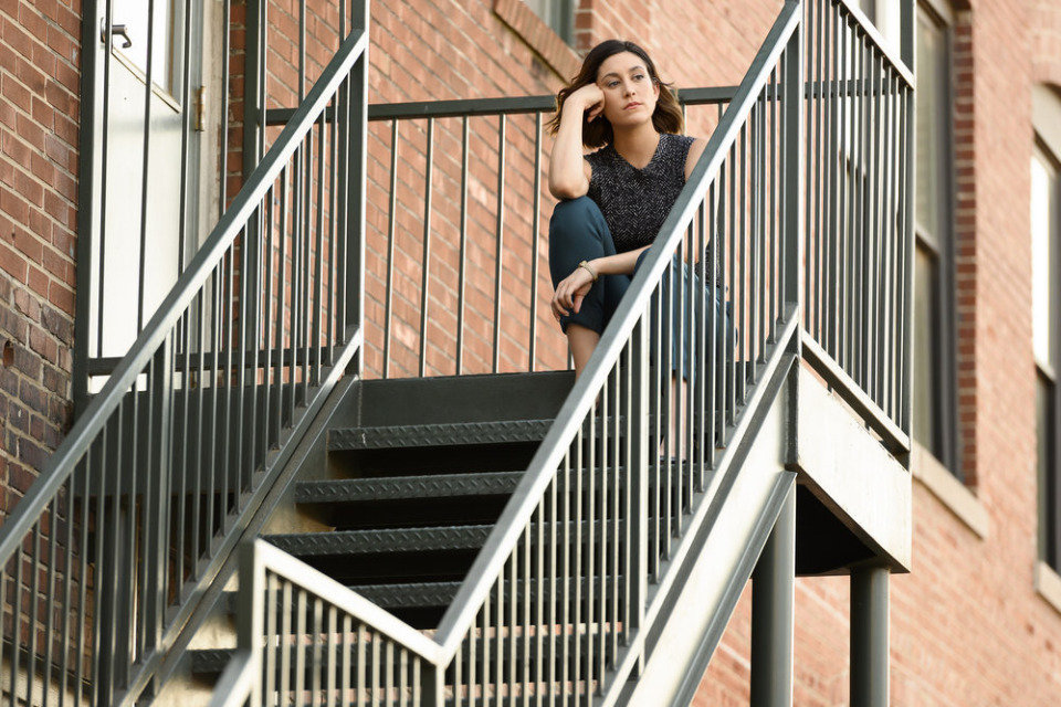 """<strong>Sydney Strait (Caitlin McGee) has a pensive moment outside the Strait &amp; Associates' South Front Street offices in Episode 8 of """"Bluff City Law.""""&nbsp;</strong>(Katherine Bomboy/NBC)"""