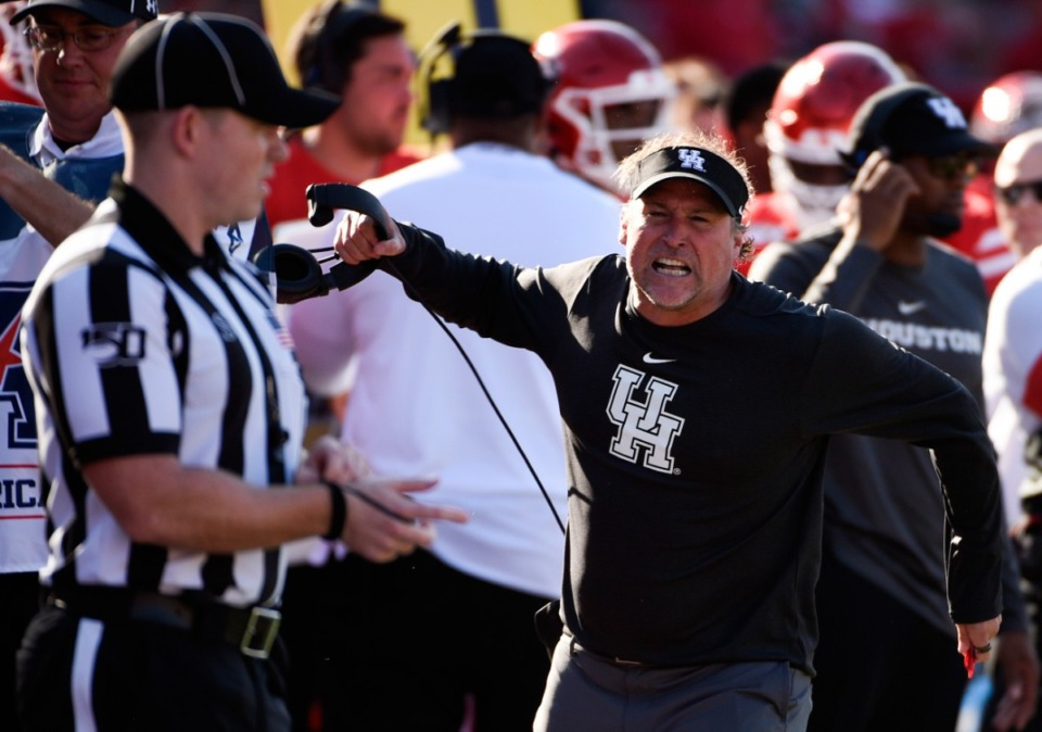 <strong>Houston head coach Dana Holgorsen yells at an official during the second half of an NCAA college football game against Cincinnati Oct. 12 in Houston.</strong>&nbsp;(Eric Christian Smith/AP)