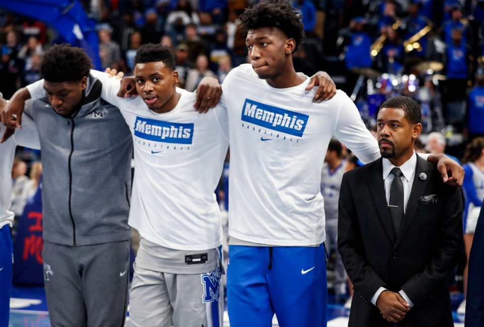 <strong>Memphis center James Wiseman (second right) stands with his teammates during the national anthem before taking on UIC Nov. 8 at FedExForum.</strong> (Mark Weber/Daily Memphian)