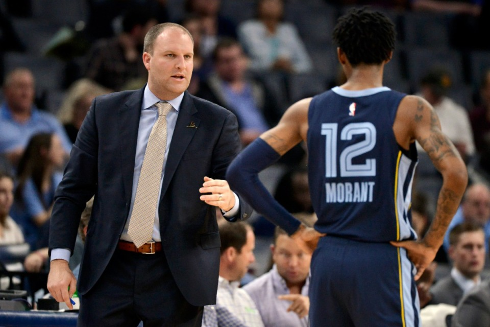 <strong>Memphis Grizzlies head coach Taylor Jenkins talks with guard Ja Morant (12) in the first half of an NBA basketball game against the Minnesota Timberwolves Wednesday, Nov. 6, 2019, in Memphis, Tenn.</strong> (AP Photo/Brandon Dill)