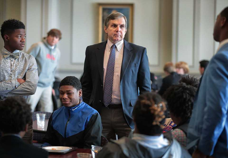 <strong>Memphis University School headmaster Pete Sanders talks to students before the start of classes on Oct. 19, 2018. MUS is celebrating its 125th anniversary this year with banners, a Founders Day, commemorative caps and a new history book.</strong> (Jim Weber/Daily Memphian)