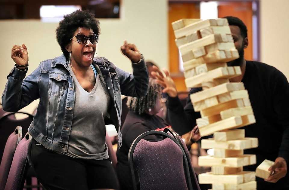 <strong>Keartra Smith celebrates as the tower comes tumbling down on Siju Crawford while playing games at an Up the Vote Block Party on Oct. 31, 2018, at First Baptist Church on Broad. The event, geared toward boosting voter participation, drew area residents with games, music, food and information booths.</strong> (Jim Weber/Daily Memphian)