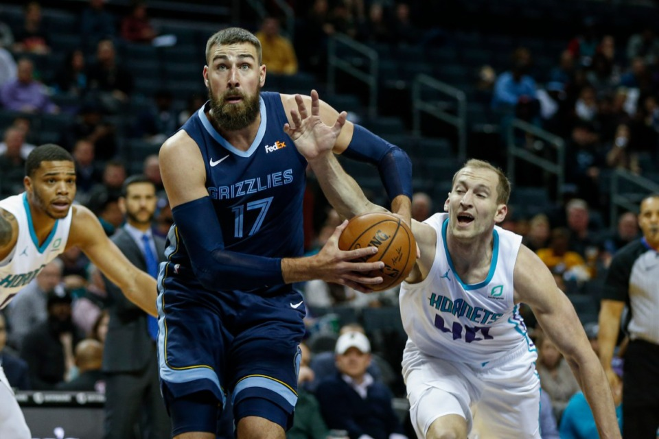 <strong>Charlotte Hornets center Cody Zeller, right, reaches in to strip the ball from Memphis Grizzlies center Jonas Valanciunas in the first half of an NBA basketball game in Charlotte, N.C., Nov. 13.</strong> (Nell Redmond/AP)