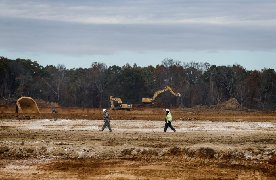<strong>Dozens of pieces of heavy equipment are being used on Nov. 14, 2019, to clear and shape the southwest corner of New Allen and Hawkins Mill roads on land that Amazon has bought.</strong> (Mark Weber/Daily Memphian)