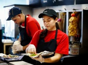 <strong>Majd Arar (left) and Evelyn Frutos make gyros at the Happy Greek Caf&eacute; restaurant on Highland Avenue on Wednesday, Nov. 13.</strong> (Mark Weber/Daily Memphian)