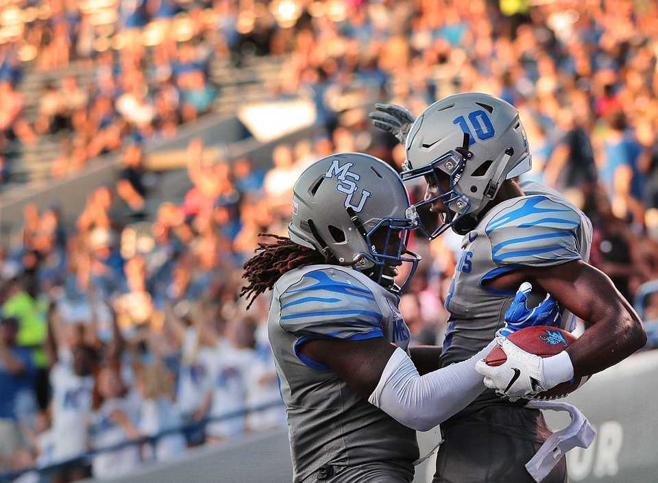 <strong>Tiger's running back Darrell Henderson celebrates with Tigers wide receiver Damonte Coxie (10) after a touchdown during the Tiger's game against Georgia State at the Liberty Bowl Memorial Stadium on September 14, 2018. The University of Memphis beat Georgia 59-22.&nbsp;</strong><span>(Jim Weber/Daily Memphian)</span>