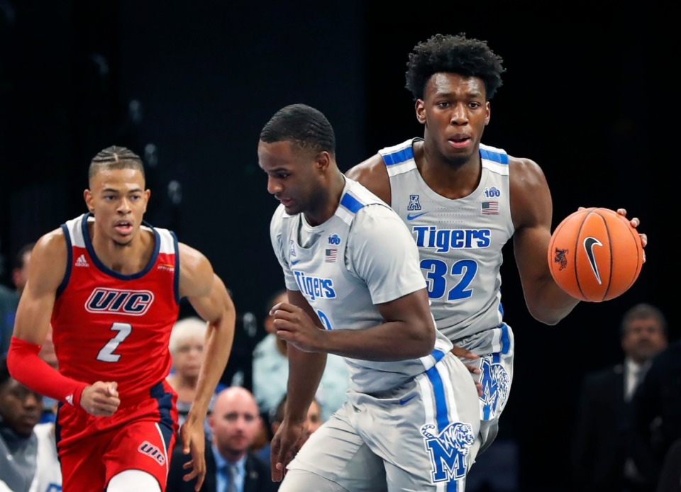 <strong>Memphis center James Wiseman (right) brings the ball up the court against UIC on Friday, Nov. 8, at FedExForum.</strong> (Mark Weber/Daily Memphian)