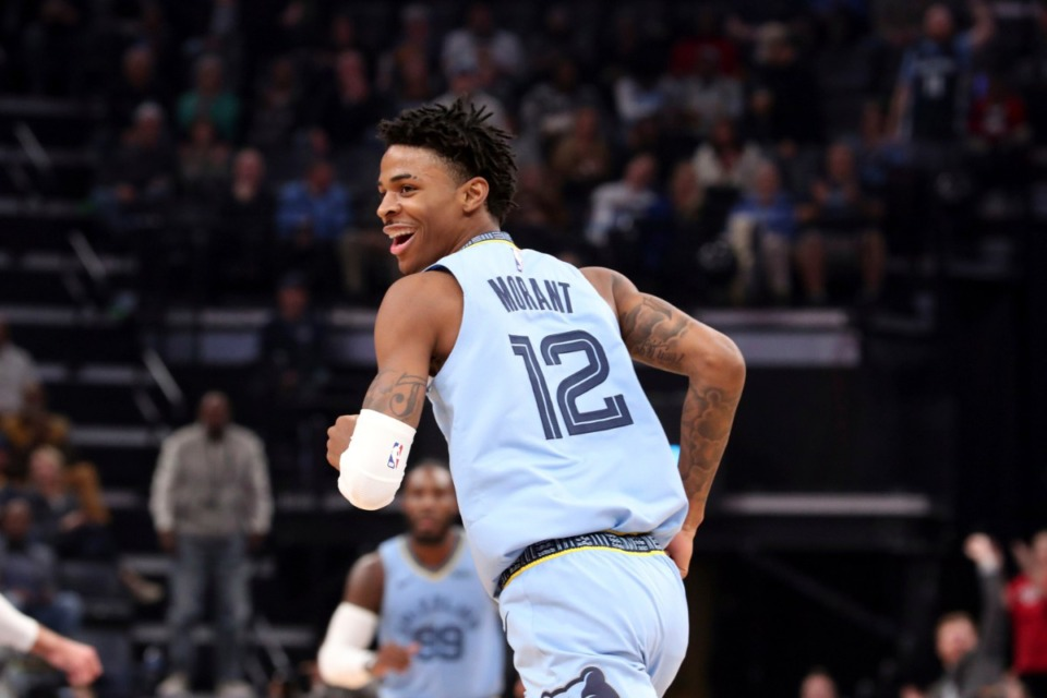 <strong>Memphis guard Ja Morant looks back and smiles after a dunk against the Utah Jazz Nov. 15 at FedExForum.</strong> (Karen Pulfer Focht/AP)