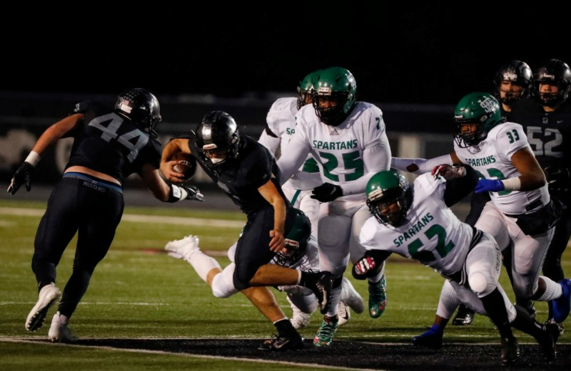 <strong>Houston running back Lincoln Pare (with ball) rushes past White Station Nov. 15.</strong> (Mark Weber/Daily Memphian)