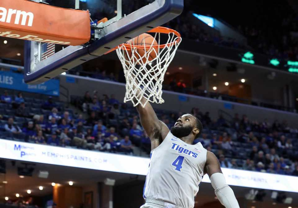 <strong>Memphis Tigers' Raynere Thornton (4) slam dunks during the first half in the game against Christian Brothers at FedExForum on Nov. 2, 2018.</strong>&nbsp;(Karen Pulfer Focht/Special to The Daily Memphian)