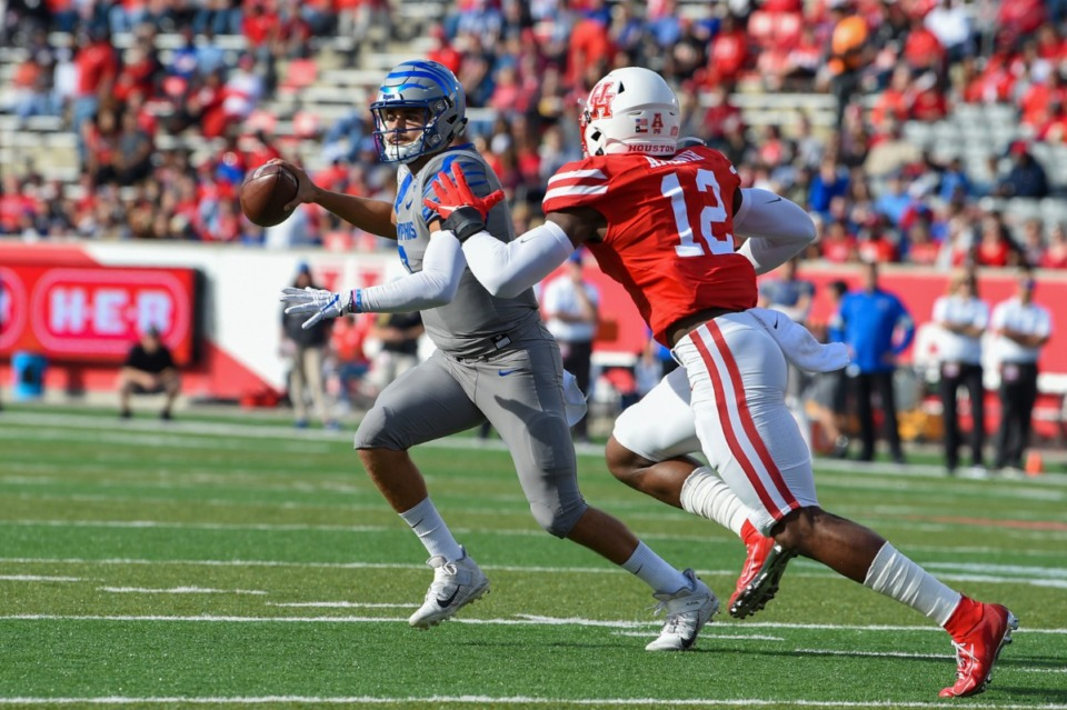 <strong>University of Memphis quarterback Brady White (3) is flushed from the pocket by Houston defensive lineman David Anenih (12) during the football game between the Tigers and Cougars at TDECU Stadium on Nov. 16, 2019 in Houston.</strong> (Icon Sportswire via AP Images)