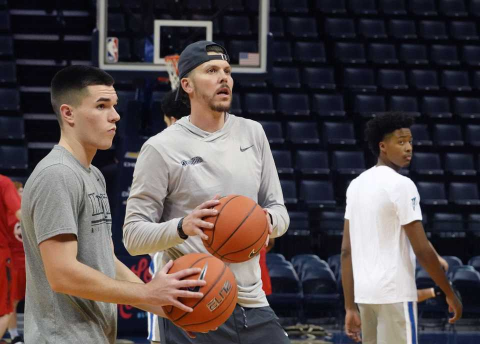 <strong>Memphis Tigers' assistant coach Mike Miller (center) works out with players before the game against Christian Brothers at FedExForum on Nov. 2, 2018. Miller played seven seasons with the Memphis Grizzlies.</strong> (Karen Pulfer Focht/Special to The Daily Memphian)