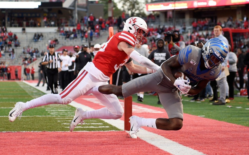 Memphis wide receiver Damonte Coxie, right, scores a touchdown as Houston safety Garrison Vaughn defends during the second half of an NCAA college football game, Saturday, Nov. 16, 2019, in Houston. (AP Photo/Eric Christian Smith)
