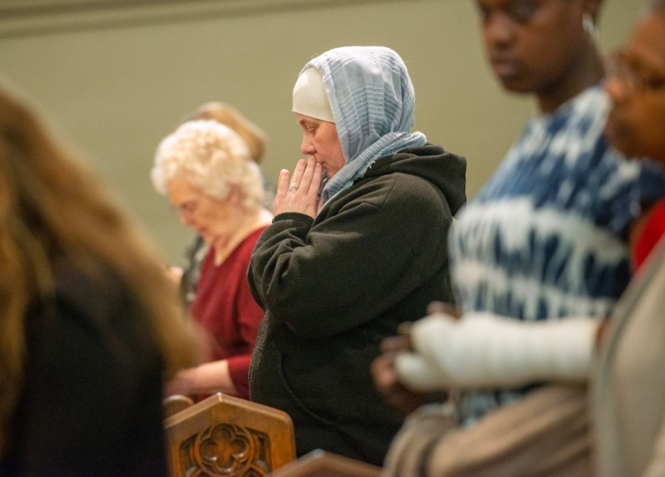 <strong>Monika Coats prays during the mass marking the 180th anniversary of the first Catholic Mass in Memphis, Sunday, November 17, 2019 at St. Peter Church</strong> (Greg Campbell/Special to The Daily Memphian)