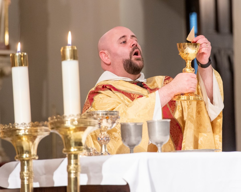 <strong>Father Augustine DeArmond prepares for the eucharist at the 180th anniversary mass of the first Catholic Mass in West Tennessee,&nbsp; Nov. 17, 2019, at St. Peter Church.&nbsp;</strong>(Greg Campbell/ Special to The Daily Memphian)