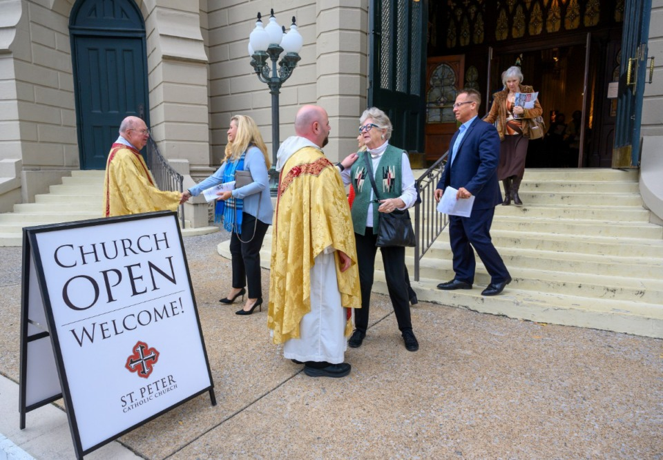<strong>Father Augustine DeArmond and Deacon Eddie Ramsey greet parishioners after Mass marking the 180th anniversary of the first Catholic service in Memphis, Nov. 17, 2019 at St. Peter Church.</strong> (Greg Campbell/ Special to The Daily Memphian)