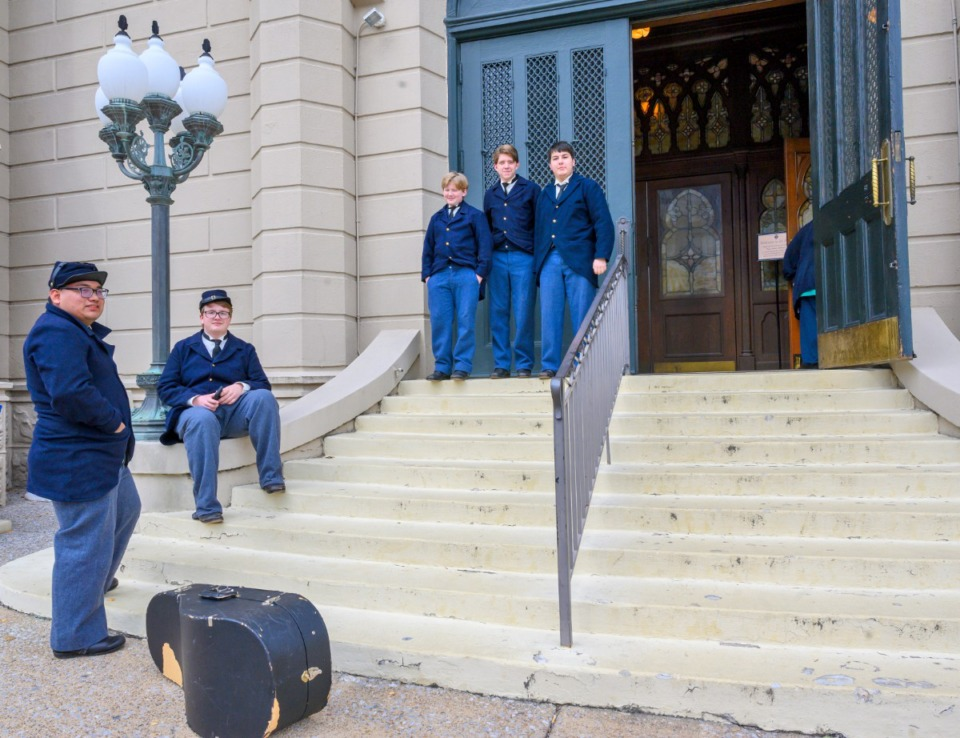 <strong>Members of the Christian Brothers High School band wait outside St. Peter Church before performing next door on the lawn of the Magevney House, site of the first Mass in Memphis.</strong> (Greg Campbell/ Special for The Daily Memphian)