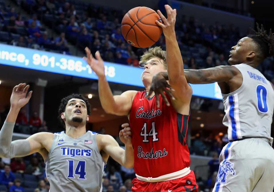 <strong>Memphis Tigers' Isaiah Maurice (14) and Kyvon Davenport (0) move in on Christian Brothers' Jacob Lyons in the second halfof an exhibition basketball game at FedExForum Friday night. The Tigers won, 95-68.</strong> (Karen Pulfer Focht/Special to The Daily Memphian)