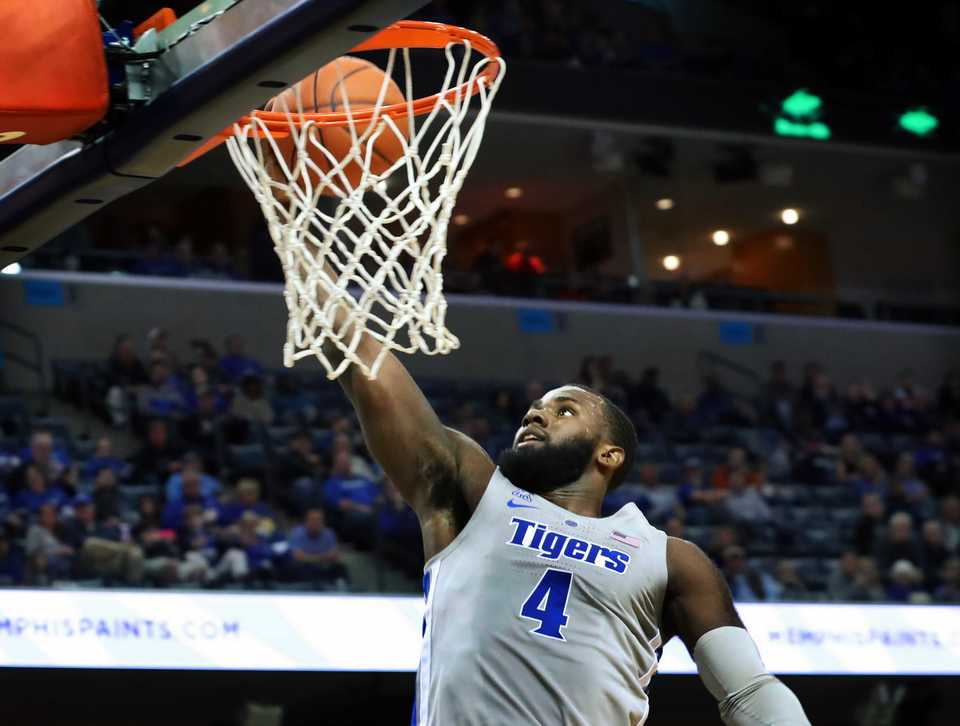 <strong>Memphis Tigers' Raynere Thornton (4) slam dunks during the first half in the game against Christian Brothers at FedExForum Friday night.</strong> (Karen Pulfer Focht/Special to The Daily Memphian)