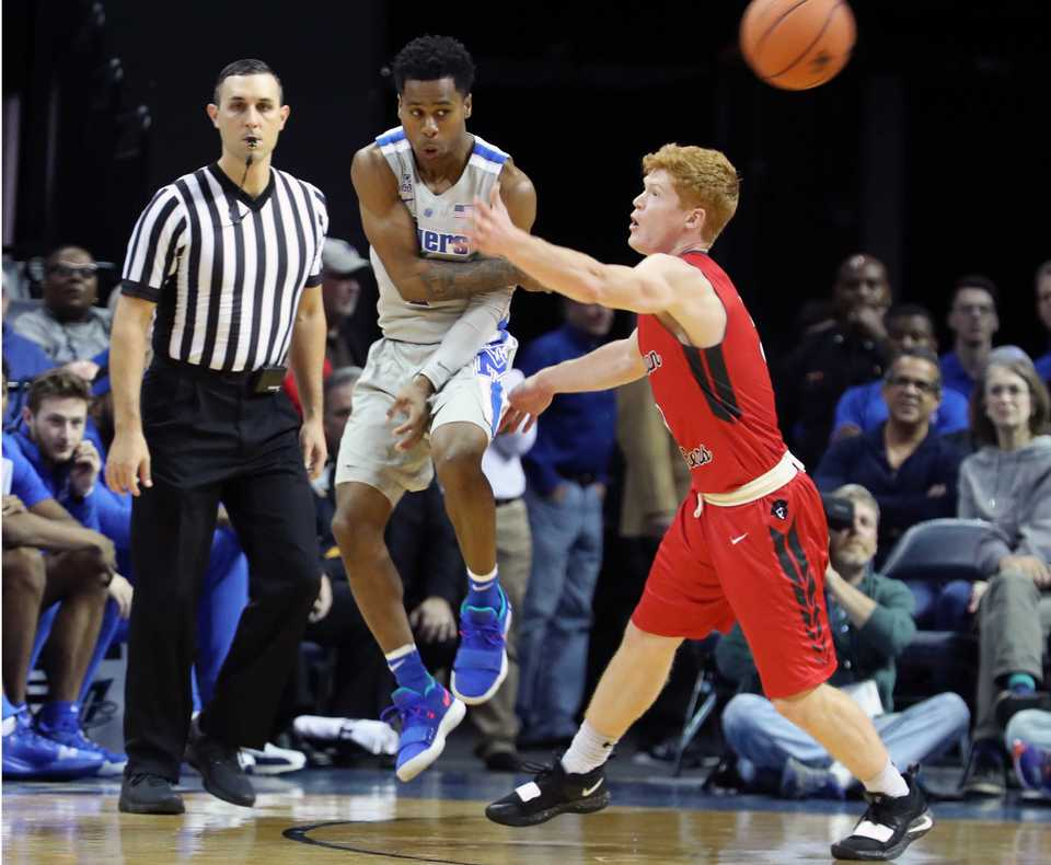 <strong>Memphis Tigers' Tyler Harris (1) pitches the ball away from Christian Brothers' Aiden Ruthsatz (5) in the second half of an exhibition basketball game at FedExForum Friday night. The Tigers won, 95-68.</strong> &nbsp;(Karen Pulfer Focht/Special to The Daily Memphian)