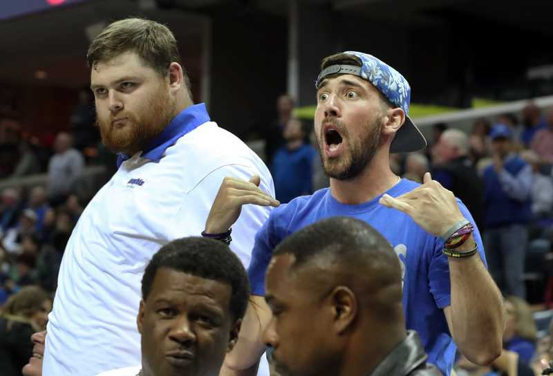 <strong>Memphis Tigers fans howl in the second half of the exhibition game against Christian Brothers at FedExForum Friday night. The Tigers won 95-68.&nbsp;</strong>(Karen Pulfer Focht/Special to The Daily Memphian)
