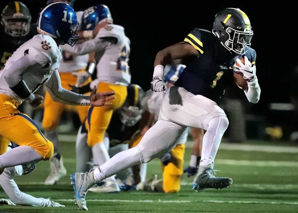 <strong>Lausanne star running back Eric Gray (1) dashes through an opening for a gain during Lausanne's game against Goodpasture Christian at Lausanne High School on Nov. 2, 2018.</strong> (Jim Weber/Daily Memphian)