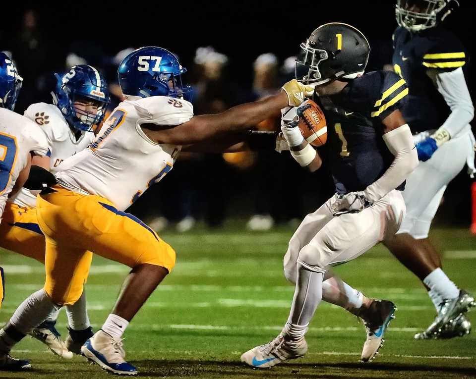<strong>Goodpasture defensive tackle Jaden Turner facemasks Lausanne running back Eric Gray (1) during Lausanne's game against Goodpasture Christian at Lausanne High School on Nov. 2, 2018.</strong> (Jim Weber/Daily Memphian)