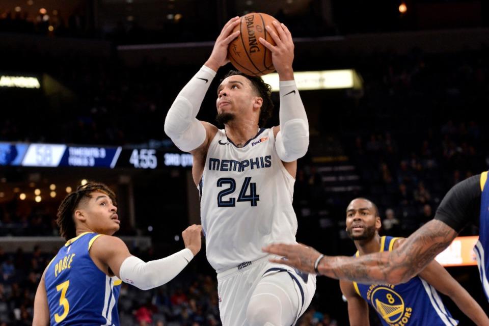 <strong>Memphis Grizzlies guard Dillon Brooks (24) shoots between Golden State Warriors guards Jordan Poole (3) and Alec Burks (8) Nov. 19 at FedExForum.</strong> (Brandon Dill/AP)