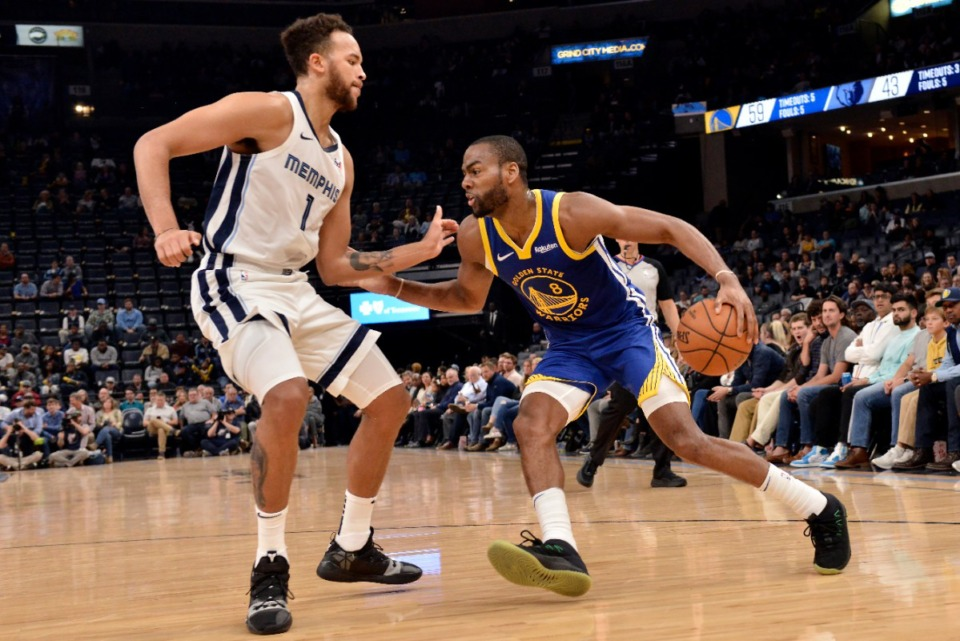 <strong>Golden State Warriors guard Alec Burks (8) drives against Memphis Grizzlies forward Kyle Anderson (1) on Nov. 19 at FedExForum.</strong> (Brandon Dill/AP)