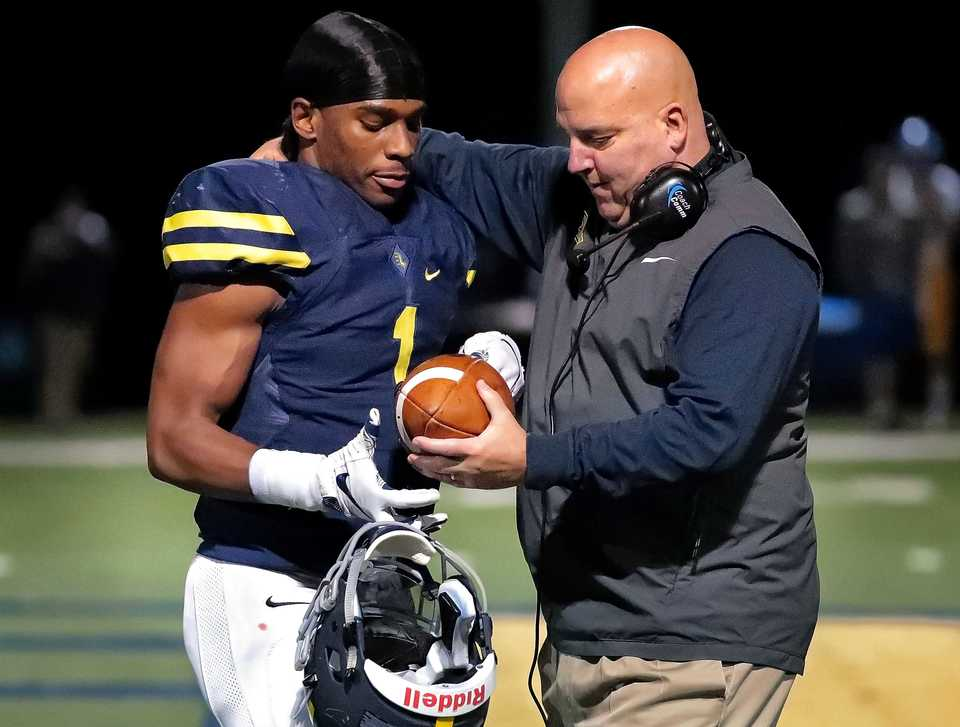 <strong>Lausanne star running back Eric Gray (left) receives the game ball from coach Kevin Locastro after beating the state record for career touchdowns during Lausanne's game against Goodpasture Christian at Lausanne High School on Nov. 2, 2018.</strong> (Jim Weber/Daily Memphian)